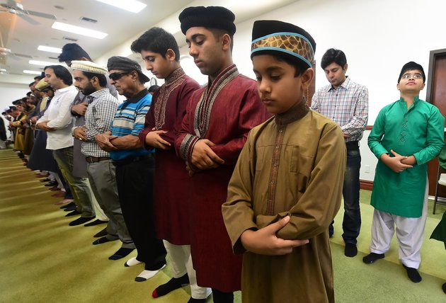 Muslims pray while celebrating Eid al-Fitr, marking the end of fasting during the month-long Ramadan, at the Baitul Hameed Mosque in Chino, California on July 6, 2016. The Pew Research center estimated earlier this year there were about 3.3 million Muslims of all ages living in the United States in 2015. / AFP / Frederic J. BROWN (Photo credit should read FREDERIC J. BROWN/AFP/Getty Images)